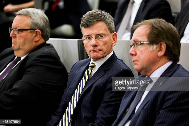 L to R National MPs Gerry Brownlee Chris Finlayson and Murray McCully look on while New Zealand Prime Minister John Key delivers a national security...