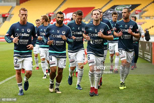 L to R Oliver Bozanic Fahid Ben Khalfallah Nick Ansell Leigh Broxham and Carl Valeri of Melbourne Victory leave the field after warming up during the...