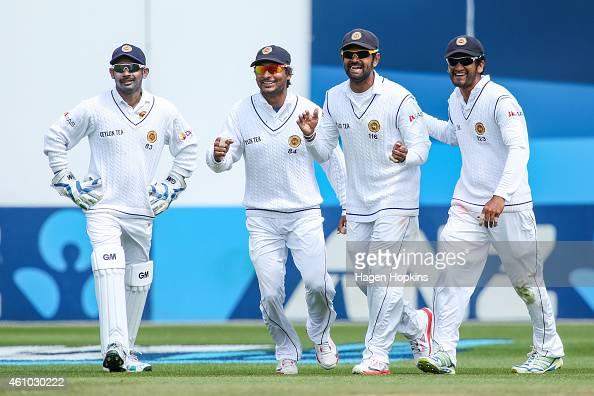 L to R Prasanna Jayawardene Kumar Sangakkara Lahiru Thirimanne and Dimuth Karunaratne of Sri Lanka celebrate the wicket of James Neesham of New...