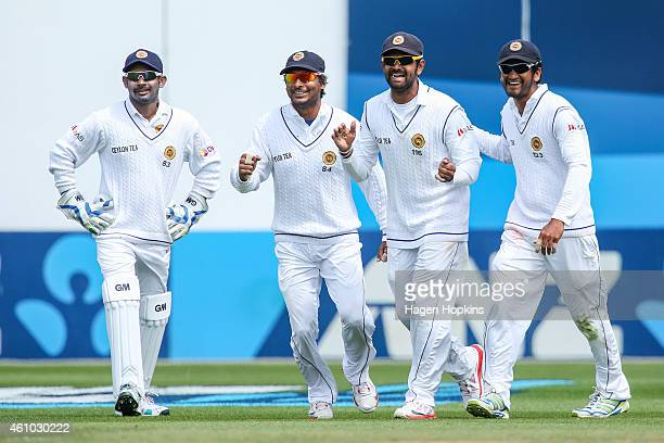 L to R Prasanna Jayawardene Kumar Sangakkara Lahiru Thirimanne and Dimuth Karunaratne of Sri Lanka celebrate the wicket of James Neesham of New...