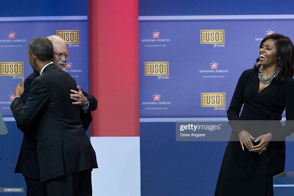 L to R, President <a gi-track='captionPersonalityLinkClicked' href=/galleries/search?phrase=Barack+Obama&family=editorial&specificpeople=203260 ng-click='$event.stopPropagation()'>Barack Obama</a> hugs David Letterman as First Lady <a gi-track='captionPersonalityLinkClicked' href=/galleries/search?phrase=Michelle+Obama&family=editorial&specificpeople=2528864 ng-click='$event.stopPropagation()'>Michelle Obama</a> looks on during a comedy show organized by United Services Organizations (USO) for members of the military and their families, at Andrews Air Force Base, May 5, 2016, in Joint Base Andrews, Maryland. The program is also being live streamed for active duty service members stationed at bases domestically and abroad.