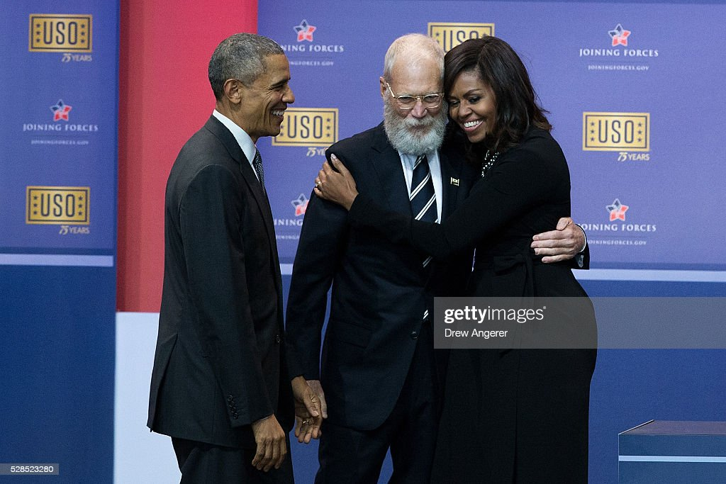 L to R, President <a gi-track='captionPersonalityLinkClicked' href=/galleries/search?phrase=Barack+Obama&family=editorial&specificpeople=203260 ng-click='$event.stopPropagation()'>Barack Obama</a> looks on as David Letterman hugs First Lady <a gi-track='captionPersonalityLinkClicked' href=/galleries/search?phrase=Michelle+Obama&family=editorial&specificpeople=2528864 ng-click='$event.stopPropagation()'>Michelle Obama</a> during a comedy show organized by United Services Organizations (USO) for members of the military and their families, at Andrews Air Force Base, May 5, 2016, in Joint Base Andrews, Maryland. The program is also being live streamed for active duty service members stationed at bases domestically and abroad.