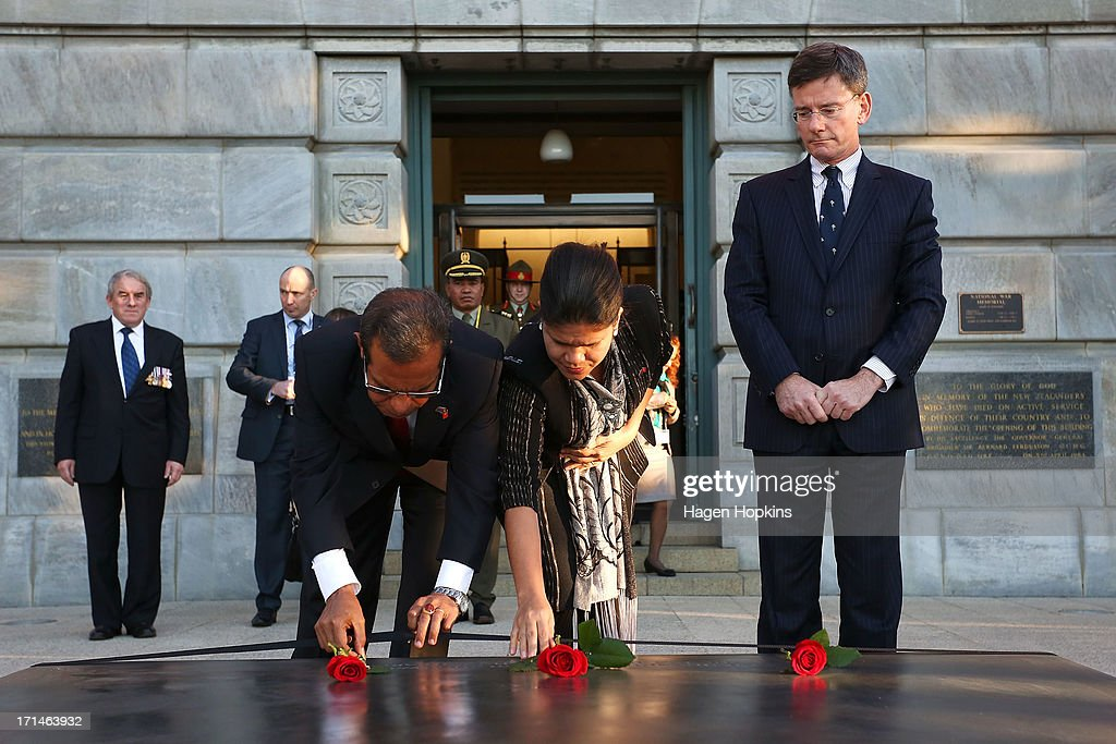 L to R, President of the Democratic Republic of Timor-Leste, Taur Matan Ruak, First Lady, Isabel da Costa Ferreira and National MP Christopher Finlayson lay roses on the tomb of the unknown soldier during a wreath laying ceremony at the National War Memorial on June 25, 2013 in Wellington, New Zealand. President Taur Matan Ruak of the Democratic Republic of Timor-Leste is in Wellington on an official visit until Thursday, June 27.