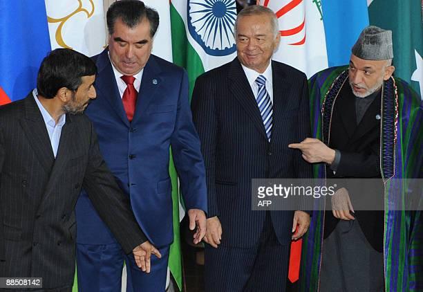 Presidents Mahmoud Ahmadinejad of Iran Emomali Rakhmon of Tajikistan Islam Karimov of Uzbekistan and Hamid Karzai of Aghanistan pose for a group...
