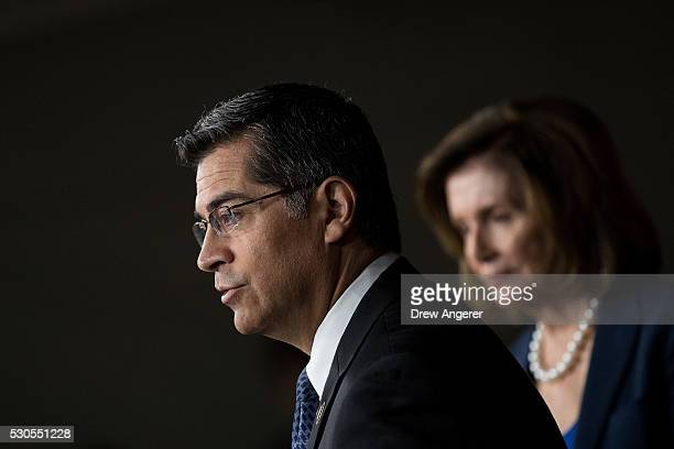 L to R Rep Xavier Becerra speaks as House Minority Leader Nancy Pelosi looks on during a news conference to discuss the rhetoric of presidential...
