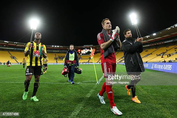 L to R Roly Bonevacia Glen Moss and Vince Lia of the Phoenix applaud their fans as they leave the field during the ALeague Elimination match between...
