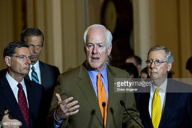 L to R Sen John Barrasso Sen John Thune Sen John Cornyn and Senate Majority Leader Mitch McConnell take questions during a news conference after a...