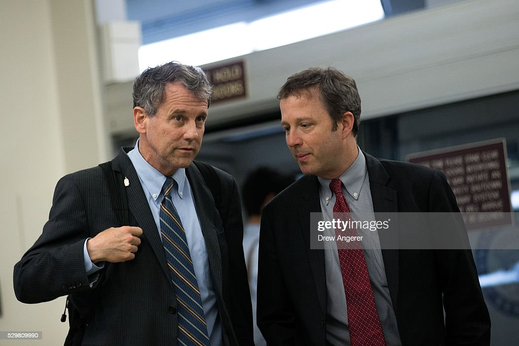 L to R, Sen. Sherrod Brown (D-OH) speaks with an aide on their way to a vote at the U.S. Capitol, May 9, 2016, in Washington, DC. Senate Democrats defeated a procedural vote on an energy bill, which increases funding for the Department of Energy and Army Corps of Engineers.