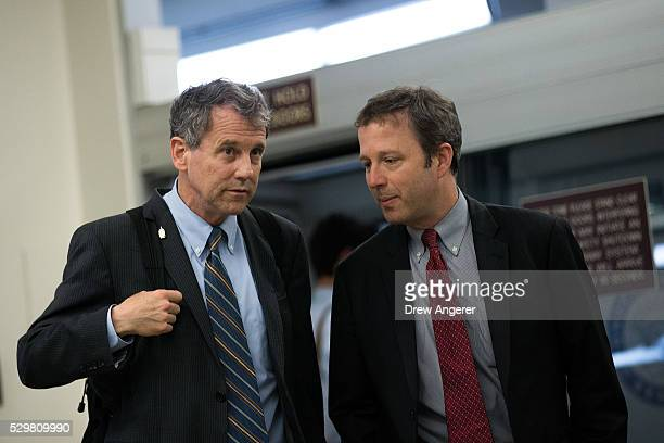 L to R Sen Sherrod Brown speaks with an aide on their way to a vote at the US Capitol May 9 in Washington DC Senate Democrats defeated a procedural...