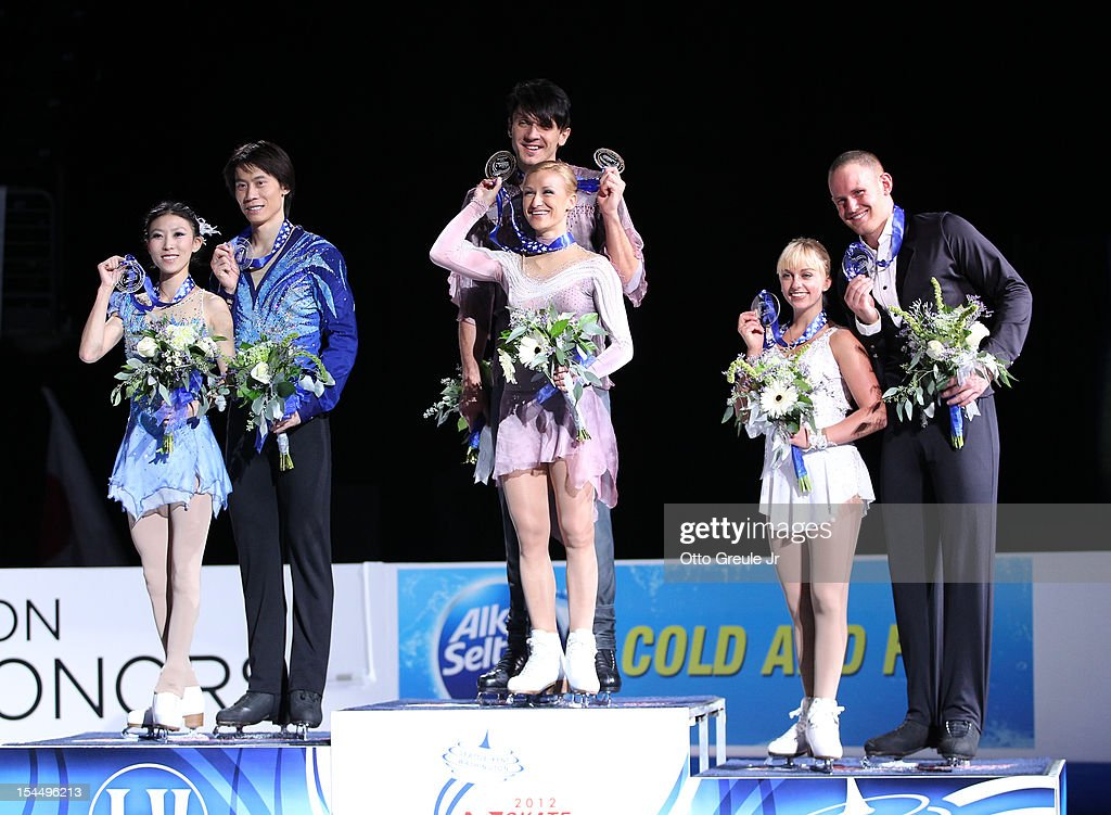 Silver medalists Qing Pang & Jian Tong of China, gold medalists <a gi-track='captionPersonalityLinkClicked' href=/galleries/search?phrase=Tatiana+Volosozhar&family=editorial&specificpeople=798077 ng-click='$event.stopPropagation()'>Tatiana Volosozhar</a> & <a gi-track='captionPersonalityLinkClicked' href=/galleries/search?phrase=Maxim+Trankov&family=editorial&specificpeople=798054 ng-click='$event.stopPropagation()'>Maxim Trankov</a> of Russia, and bronze medalists <a gi-track='captionPersonalityLinkClicked' href=/galleries/search?phrase=Caydee+Denney&family=editorial&specificpeople=5675848 ng-click='$event.stopPropagation()'>Caydee Denney</a> & John Coughlin of the USA show off their medals at the pairs free skate awards ceremony during the Skate America competition at the ShoWare Center on October 20, 2012 in Kent, Washington.