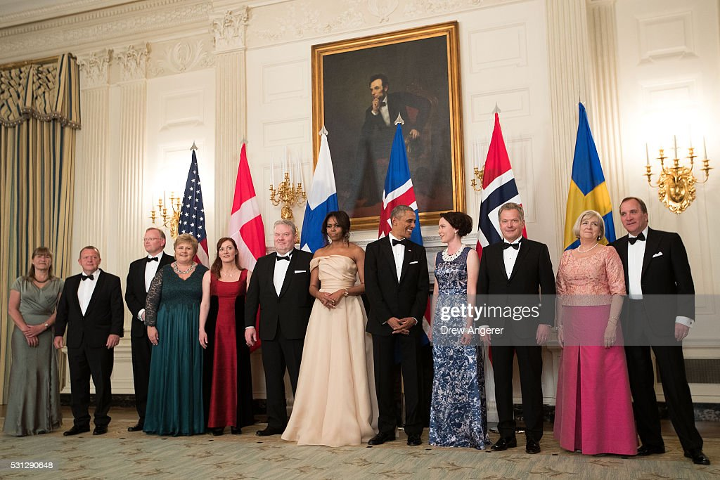 L to R, Solrun Lokke Rasmussen, Prime Minister of Denmark <a gi-track='captionPersonalityLinkClicked' href=/galleries/search?phrase=Lars+Lokke+Rasmussen&family=editorial&specificpeople=5839942 ng-click='$event.stopPropagation()'>Lars Lokke Rasmussen</a>, Sindre Finnes, Prime Minister of Norway Erna Solberg, Ingibjorg Elsa Ingjaldsdottir, Prime Minister of Iceland Sigurour Ingi Johannsson, First Lady <a gi-track='captionPersonalityLinkClicked' href=/galleries/search?phrase=Michelle+Obama&family=editorial&specificpeople=2528864 ng-click='$event.stopPropagation()'>Michelle Obama</a>, U.S. President <a gi-track='captionPersonalityLinkClicked' href=/galleries/search?phrase=Barack+Obama&family=editorial&specificpeople=203260 ng-click='$event.stopPropagation()'>Barack Obama</a>, Jenni Haukio, President of Finland Sauli Niinisto, Ulla Lofven, and Prime Minister of Sweden Stefan Lofven gather for a group photo in the State Dining Room at the White House, May 13, 2016, in Washington, DC. Leaders from Denmark, Norway, Finland, Sweden, and Iceland were invited to the White House for the U.S.-Nordic leaders summit.