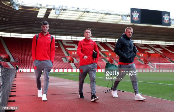 L to R Southampton's Fraser Forster Steven Davis and James WardProwse arrive ahead of the Premier League match between Southampton and Arsenal at St...