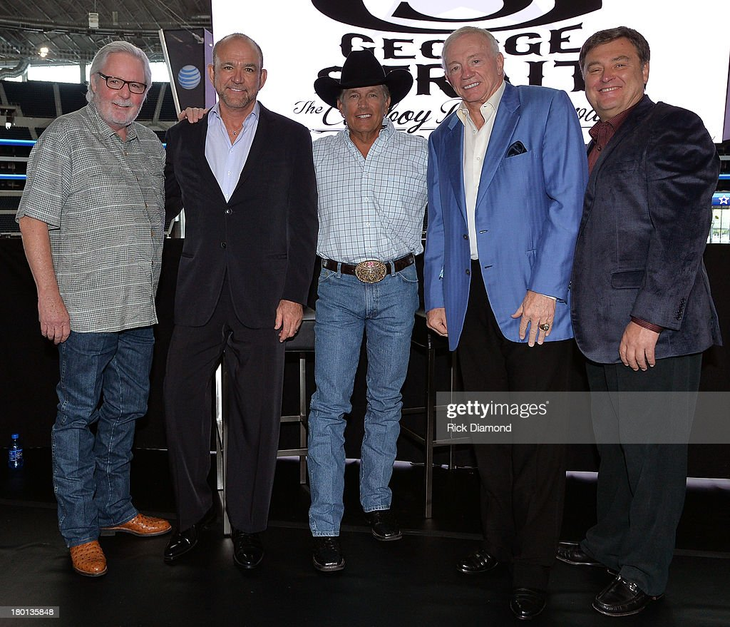 L to R Strait's longtime manager Erv Woolsey The Cowboy Rides Away Tour promoter Louis Messina of The Messina Group George Strait Jerry Jones Owner...