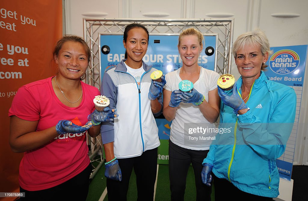 L to R, Tara Moore of Great Britain, Anne Keothoavong of Great Britain, <a gi-track='captionPersonalityLinkClicked' href=/galleries/search?phrase=Alison+Riske&family=editorial&specificpeople=6975997 ng-click='$event.stopPropagation()'>Alison Riske</a> of USA and <a gi-track='captionPersonalityLinkClicked' href=/galleries/search?phrase=Judy+Murray&family=editorial&specificpeople=582324 ng-click='$event.stopPropagation()'>Judy Murray</a> with their cup cakes that they made at a cup cake making demonstartion during the AEGON Classic Tennis Tournament at Edgbaston Priory Club on June 12, 2013 in Birmingham, England.