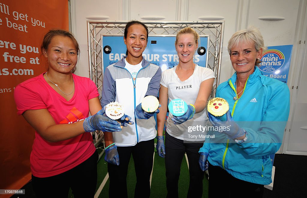 L to R, Tara Moore of Great Britain, Anne Keothoavong of Great Britain, <a gi-track='captionPersonalityLinkClicked' href=/galleries/search?phrase=Alison+Riske&family=editorial&specificpeople=6975997 ng-click='$event.stopPropagation()'>Alison Riske</a> of USA and <a gi-track='captionPersonalityLinkClicked' href=/galleries/search?phrase=Judy+Murray&family=editorial&specificpeople=582324 ng-click='$event.stopPropagation()'>Judy Murray</a> pose with their cup cakes that they made at a cup cake making demonstartion during the AEGON Classic Tennis Tournament at Edgbaston Priory Club on June 12, 2013 in Birmingham, England.