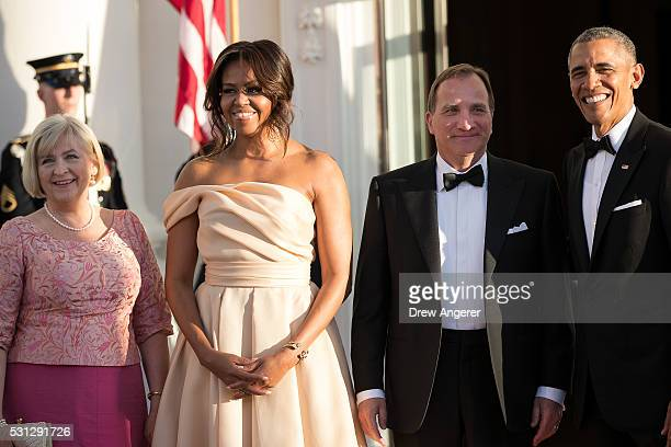 L to R Ulla Lofven First Lady Michelle Obama Prime Minister of Sweden Stefan Lofven and US President Barack Obama pose for a photo during arrivals...