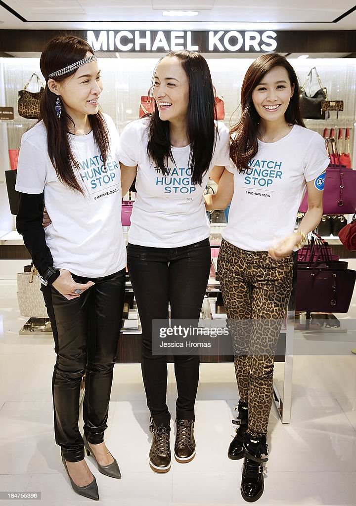 L to R -Venessa Yeung, Lisa Selesner and Fala Chen attend Michael Kors World Food Day - Hong Kong on October 16, 2013.