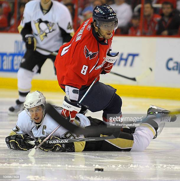 L to R Washington's Alex Ovechkin knocks Pittsburgh's Sidney Crosby to ice in the 2nd period during live action at the Washington Capital vs the...