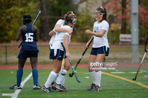 L to R York's Sydney Bouchard Barbara Conradt and Cassandra Reinertson celebrate after Conradt scored a goal against Poland in the Class B Southern...