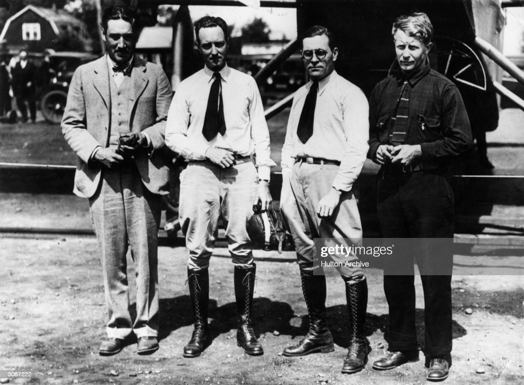 L to right, pilot, Bert Acosta, Commander Richard E Byrd (1888 - 1957), radio operator George Noville and relief pilot Lt B Balchen waiting for the storms to clear before taking off for France in their plane, 'America' in an arrempt to start a transatlantic airmail route.
