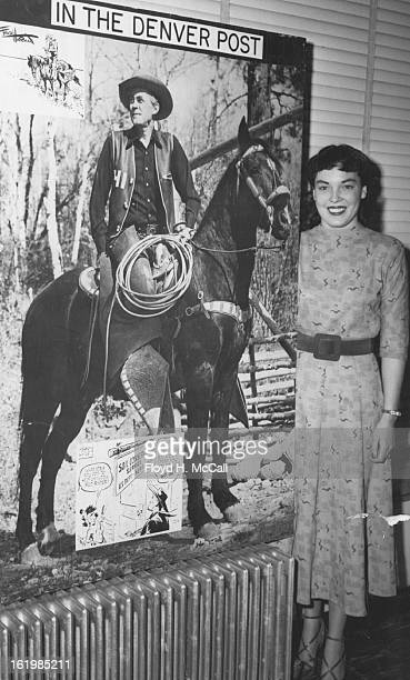 MAR 18 1951 To show the size of this photo of Fred Harman creator of the comic page cowboy Red Ryder pretty Jo Anne Duffy of 1670 Steele street stood...