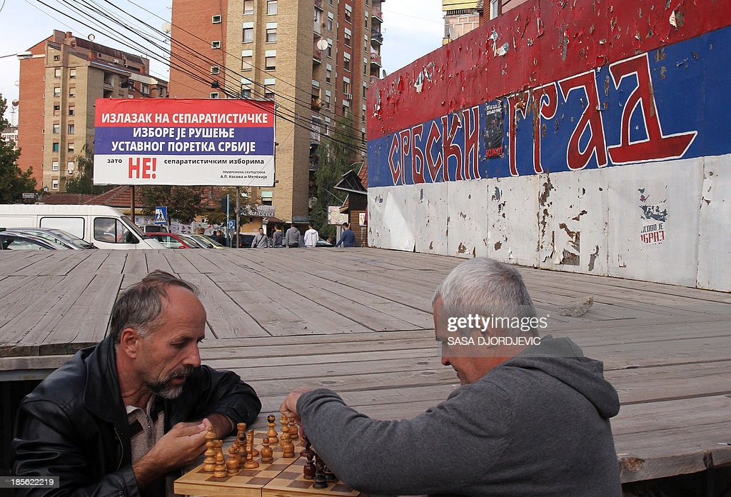'To vote or not to vote, Kosovo Serbs wonder ahead of polls' Ethnic Serbs play chess at the main square in the ethnically divided city of Kosovska Mitrovica, Northern Kosovo, on October 8, 2013. With only days ahead of November 3 local polls in Kosovo, the Serb minority is thorn between boycotting the vote organised by Pristina authorities they do not recognise, and Serbia's call to come out to the polls.