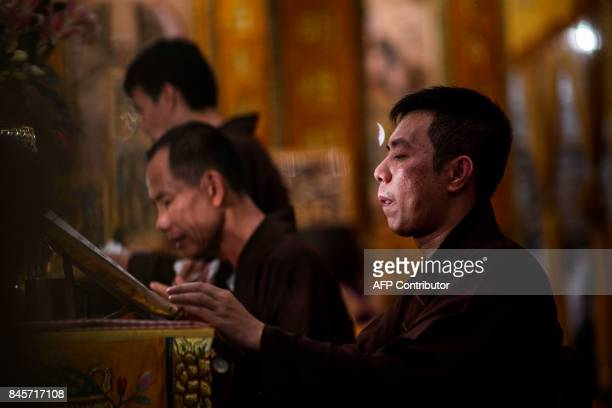 Toaist priests chant during an event to mark the Hungry Ghost Festival in Hong Kong on September 11 2017 The festival celebrated in the seventh lunar...