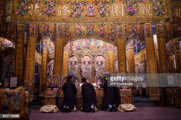 TOPSHOT Toaist priests kneel to worship during an event to mark the Hungry Ghost Festival in Hong Kong on September 11 2017 The festival celebrated...