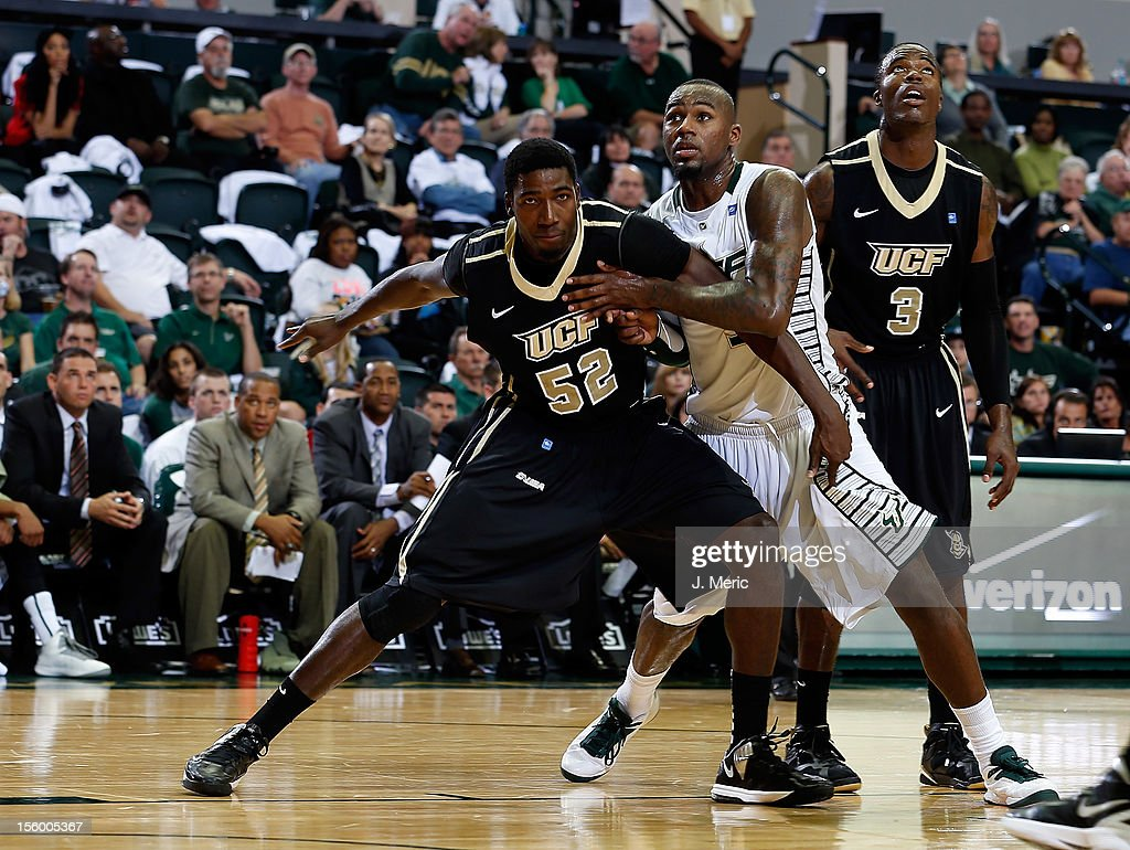 Toarlyn Fitzpatrick #32 of the South Florida Bulls battles Staphon Blair #52 of the Central Florida Knights for a rebound during the game at the Sun Dome on November 10, 2012 in Tampa, Florida.