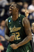 Toarlyn Fitzpatrick of the South Florida Bulls celebrates after a play against the Temple Owls during the second round of the 2012 NCAA Men's...