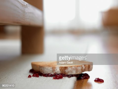 Toast and jam upside-down on carpet : Stock Photo