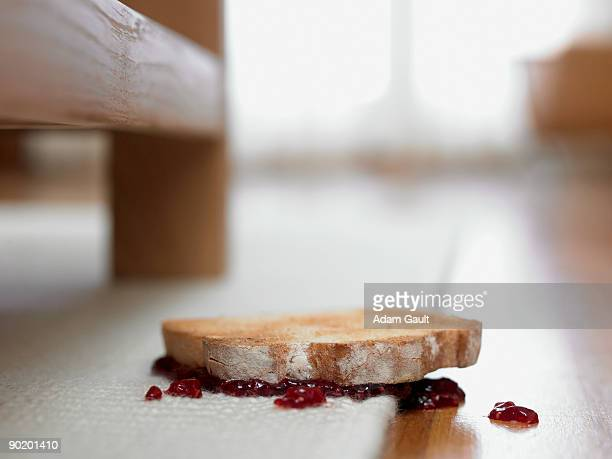 Toast and jam upside-down on carpet