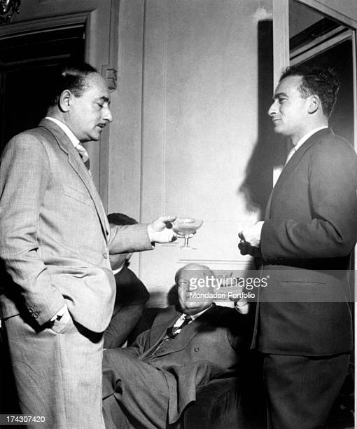 Toast between three great Italian writers Salvatore Quasimodo standing on the left and Italo Calvino on the right together with Giuseppe Ungaretti...