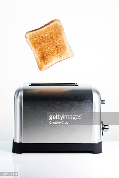 Toast popping out of electric toaster