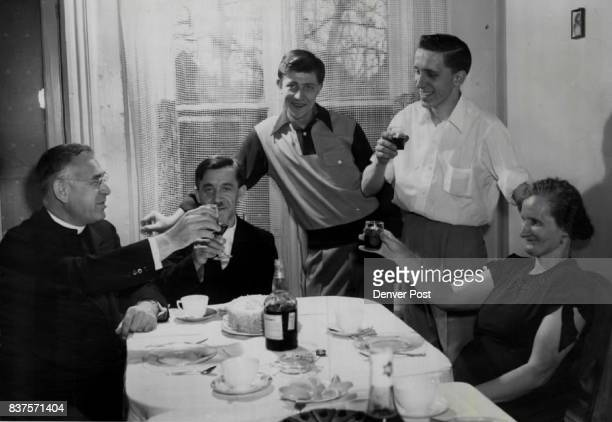 Toast Time The Karabin family drinks a toast with Father Elmer J Kolka Sr of Denver who arranged their entry to the US as displaced persons Left to...
