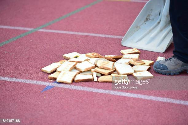 Toast Toss during the third quarter is swept up during a college football game between the Penn Quakers and the Ohio Dominican Panthers on September...