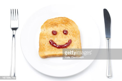 Toast with a smile of jam, fork and knife isolated : Stock Photo