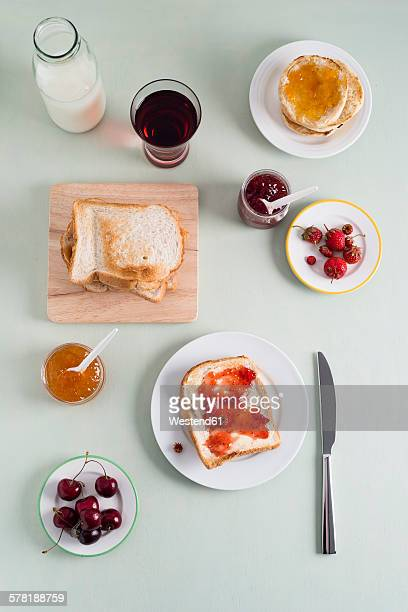 Toast with strawberry jam, toasties with apricot jam, strawberries and cherries, milk bottle