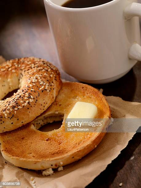 Toasted Bagel with Butter and a Coffee