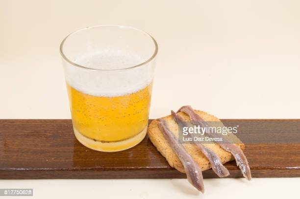 Toasted Bread with anchovies and glass of beer