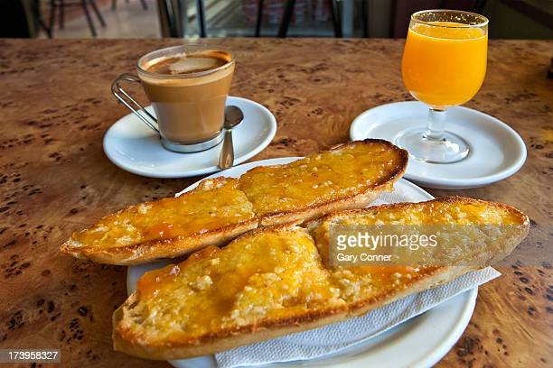 Toasted bread with juice and coffee