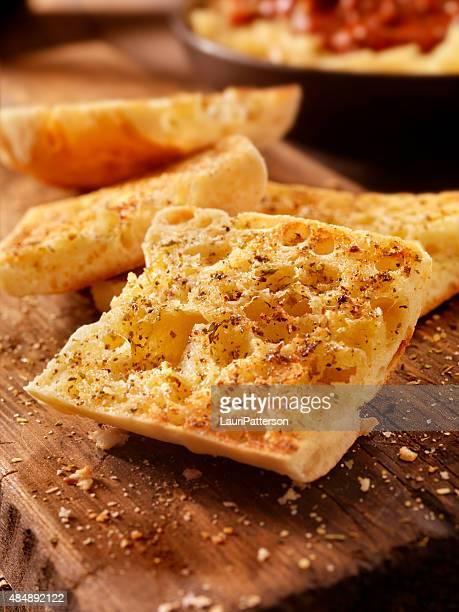 Toasted Garlic Ciabatta Bread on a Rustic Wood Cutting Board