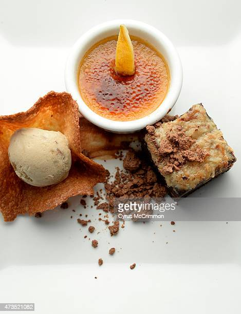 Toasted German chocolate flour less cake butterscotch creme brûlée candied lemon slice caramelia chocolate ganache coconut tuile cup and butter pecan...