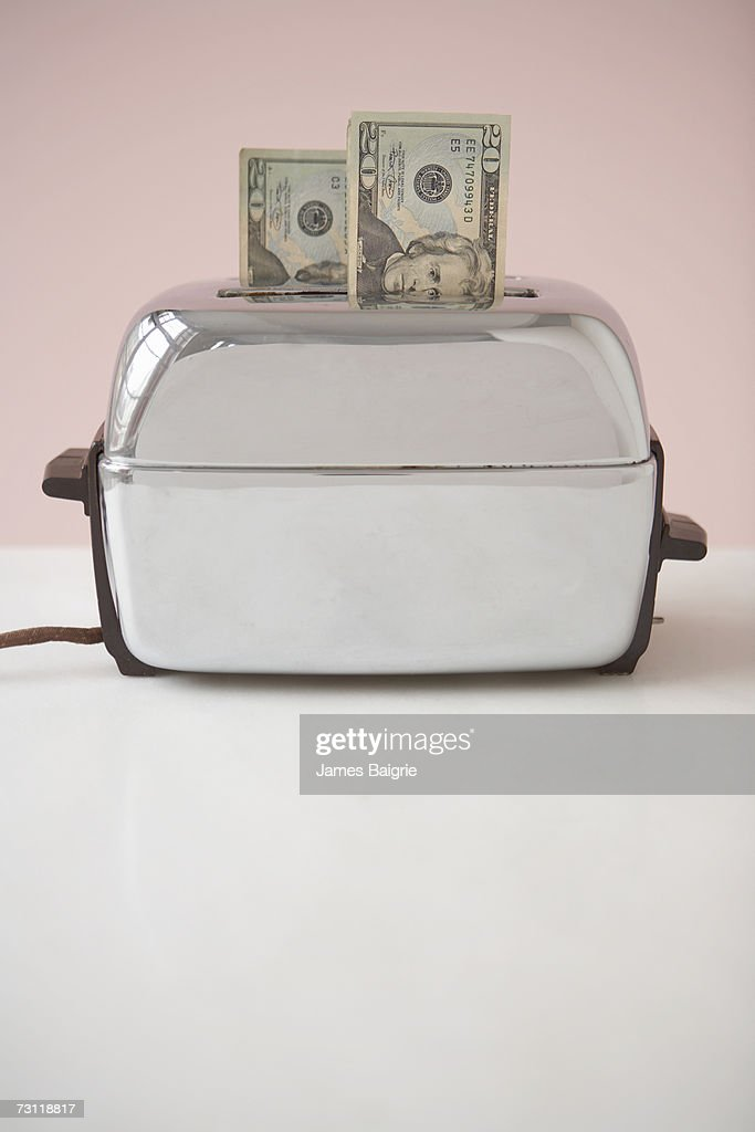 Toaster with two twenty dollar bills inserted in slots : Stock Photo