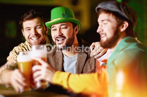 Toasting in tavern : Stock Photo
