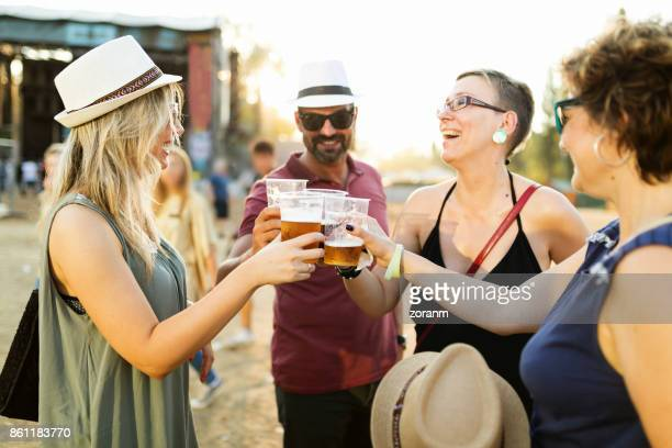 Toasting with beer at music festival
