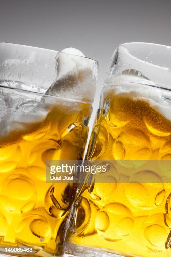 Toasting with two glasses of beer