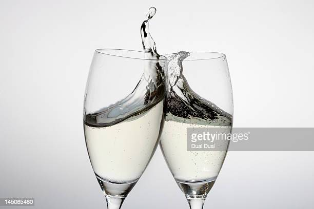 Toasting with two glasses of champagne