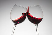 Toasting with two glasses of red wine