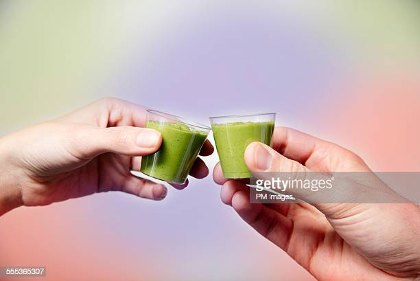 Toasting with wheat grass smoothies